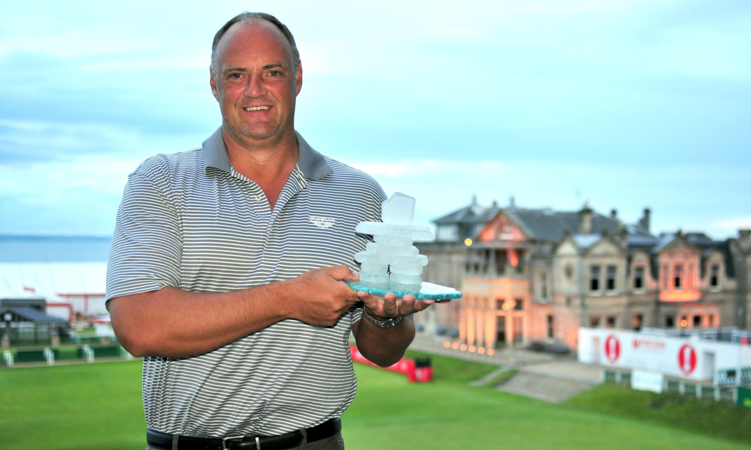 Graham Proctor, founder and CEO of St Andrews Legacy, overlooks the Old Course holding an Inukshuk, an Inuit symbol of unity and purpose, presented to him by Soldier On Canada at the launch of St Andrews Legacy in July 2013.