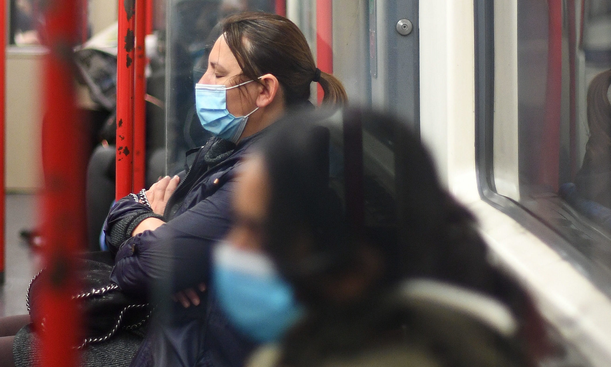 Passengers wearing masks on a train.