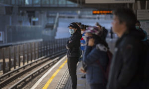 Passengers wearing face masks on a railway platform on May 12 during the lockdown.