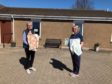 Forfar Inner Wheel member Susan Oliphant delivering bags to June McCarroll, manager at Windyedge Care Home, Forfar.