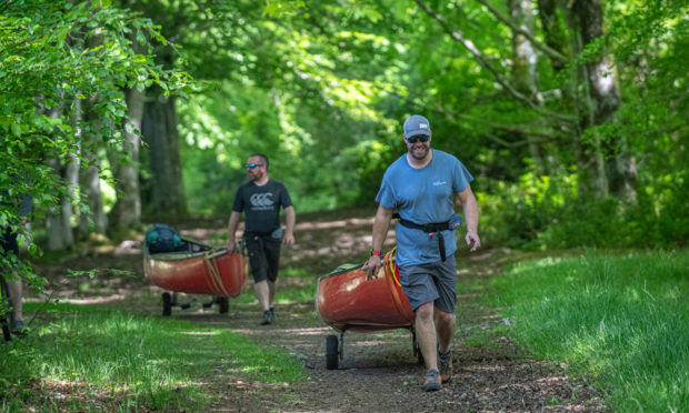 Mark French and Ross Dempster of Beyond Adventure take their canoes for a hike in aid of local causes