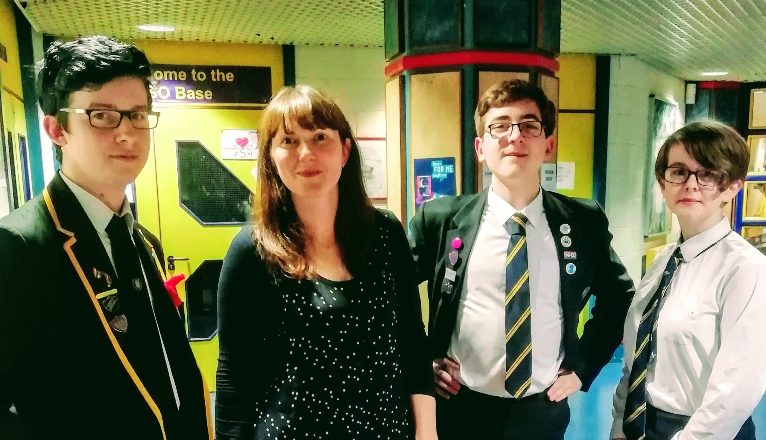 The photo shows John Hamilton, Blake McBride and Morgan Cameron of the steering group with Cara Spence in school at the end of last year.