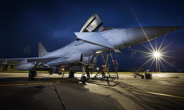 Eurofighter Typhoons taking part in a night-flying exercise.