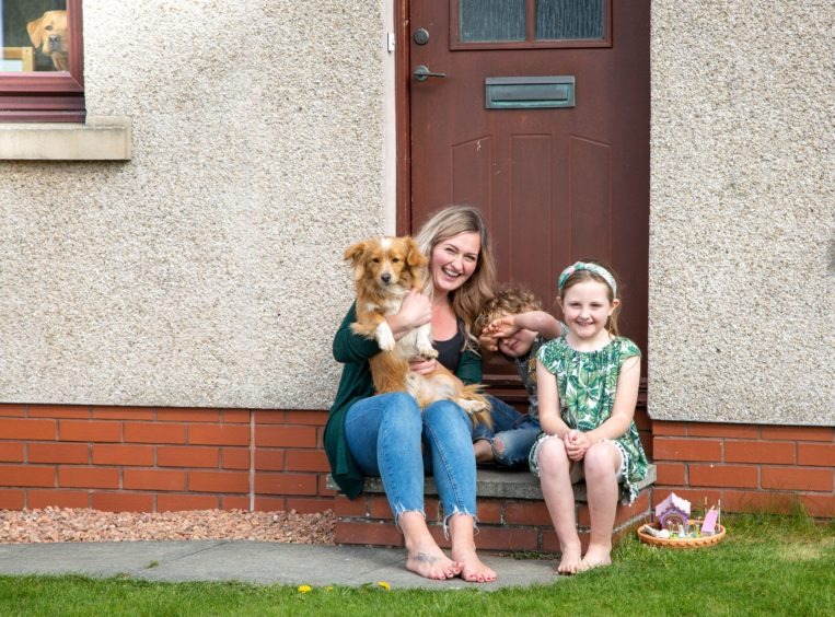 Louise Walker with Rosie and Rhys, with Rufus and Bruce in the window.