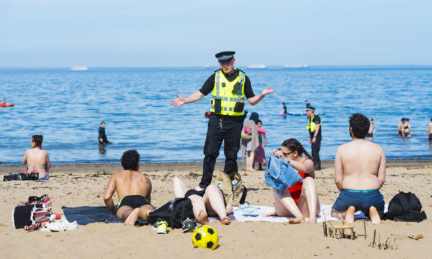 Police speak to the public at Portobello Beach during the ongoing coronavirus pandemic on May 20.