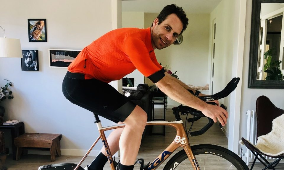 Mark Beaumont cycling in his living room