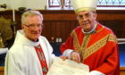 Monsignor Charles Hendry is presented withhis papal honour by Bishop Vincent Logan of Dunkeld in 2003.