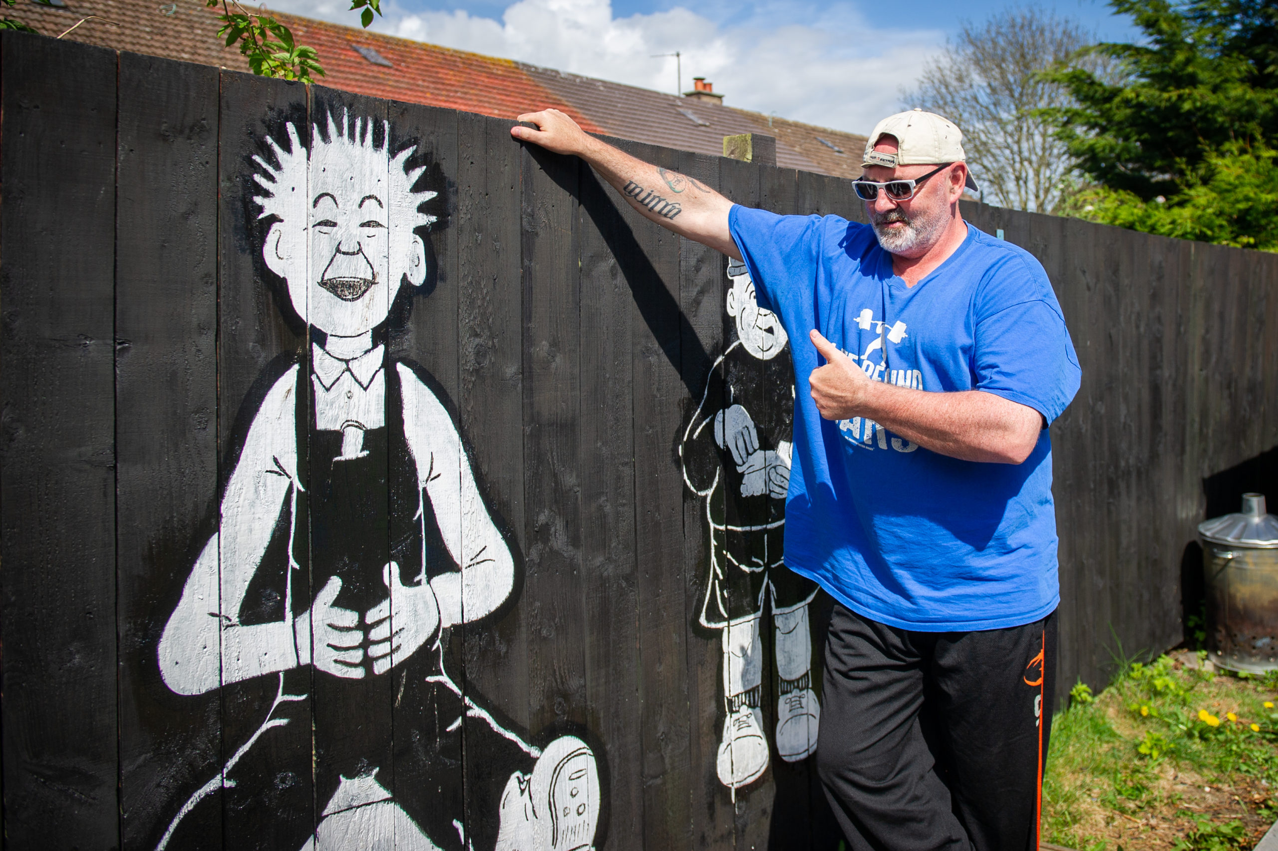 Jackie Handy has painted Oor Wullie characters onto his fence during lockdown