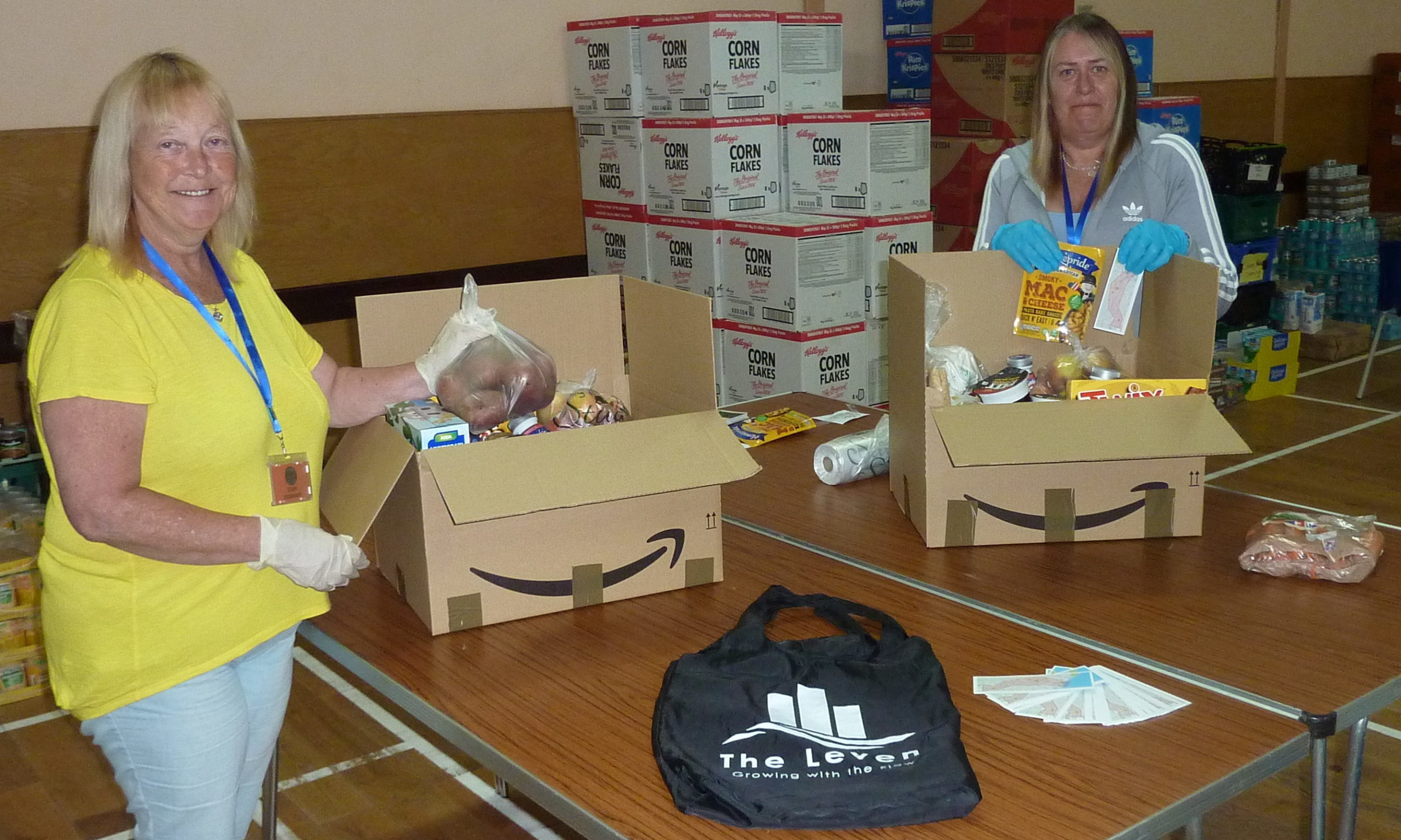 Rosemary Duncan and Vicky Skirving making food parcels at Levenmouth Food Hub and adding The Leven items encouraging engagement.