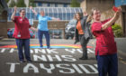 Staff take a photo with the new rainbow, left to right, Rachel Hunt, Senior Nurse, Pam Jaggard, Physio, Lynsey Laing of Wrightline Road Markings and front Gill Birrell, Senior Nurse. Tuesday 12th May, 2020.  Mhairi Edwards/DCT Media