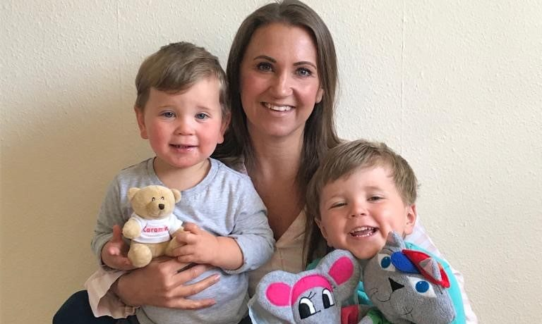 Sarah Bloice with her two sons, four-year-old Harry with puppets Mifu and Tina and two-year-old Charlie with puppet Caramelo Bear.