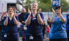 NHS Staff at the Queen Elizabeth Hospital clap for carers in early May