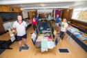 Picture shows, clockwise, left to right, members and volunteers, Willie Donaldson, Bronia Minchin, Susanne Burton, Eric Galloway, Pat Lockerbie, John Cunningham, Denise Anderson. Blairgowrie Bowling Club.
