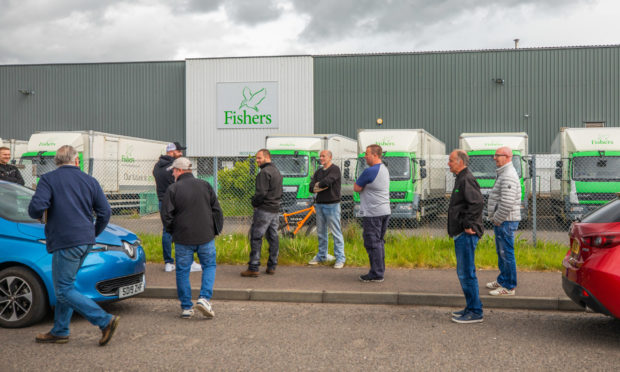 Fishers staff congregated outside the factory as talks over their futures were held on Monday morning.