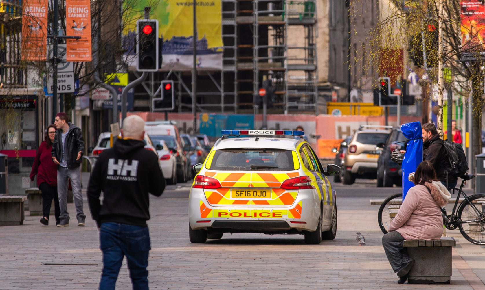 Police drive along the pedestrian High Street, Perth during the lockdown.