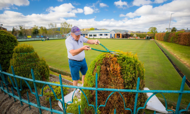Members of the Bowling Club volunteering to maintain the grounds during lockdown.