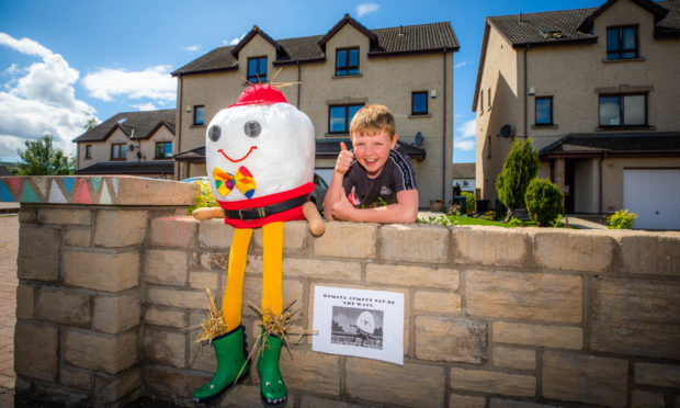 Jaxon Gahan, aged 10, with his Humpty Dumpty scarecrow.