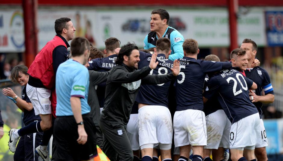Dundee squad celebrates title triumph