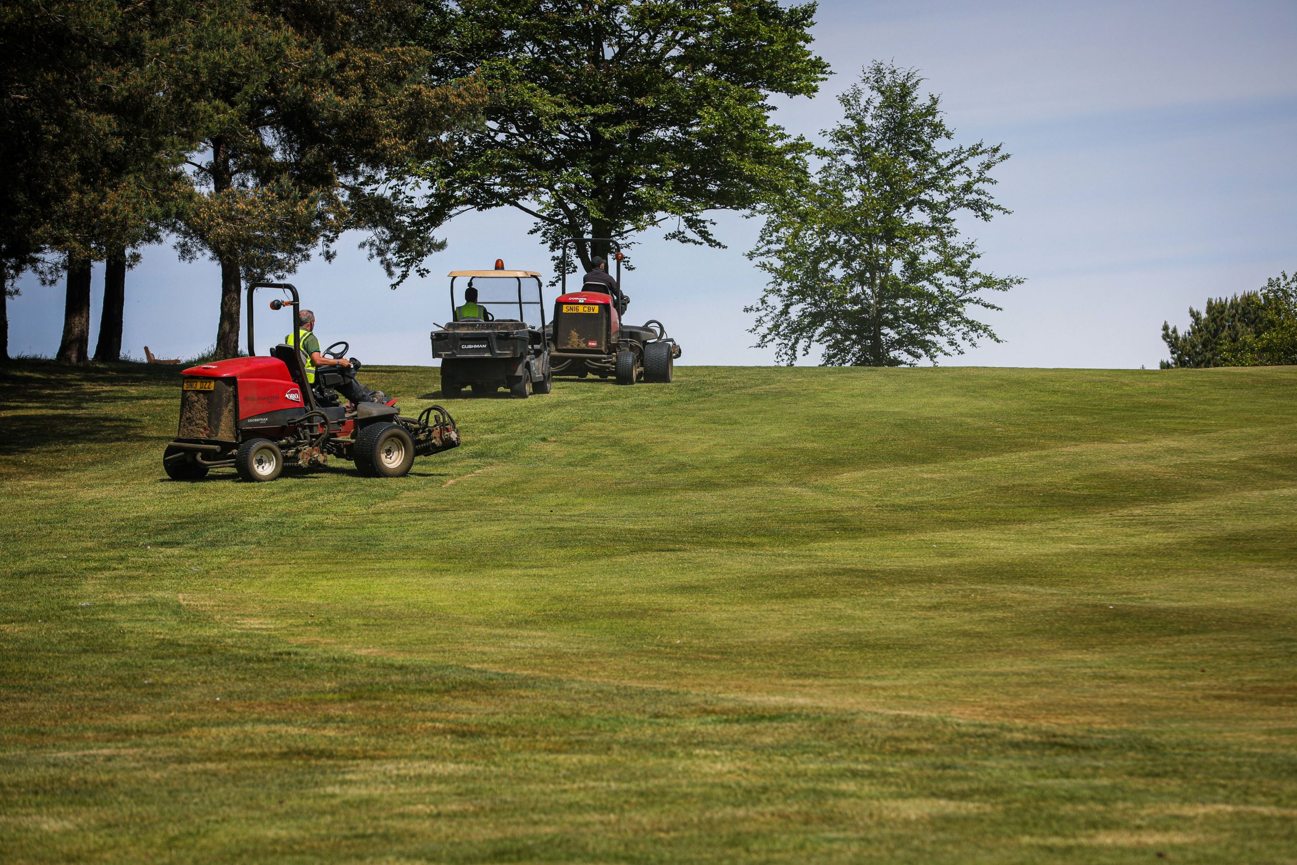 Greenkeepers get Dunnikier Park Golf Course ready for players to tee off on Friday.