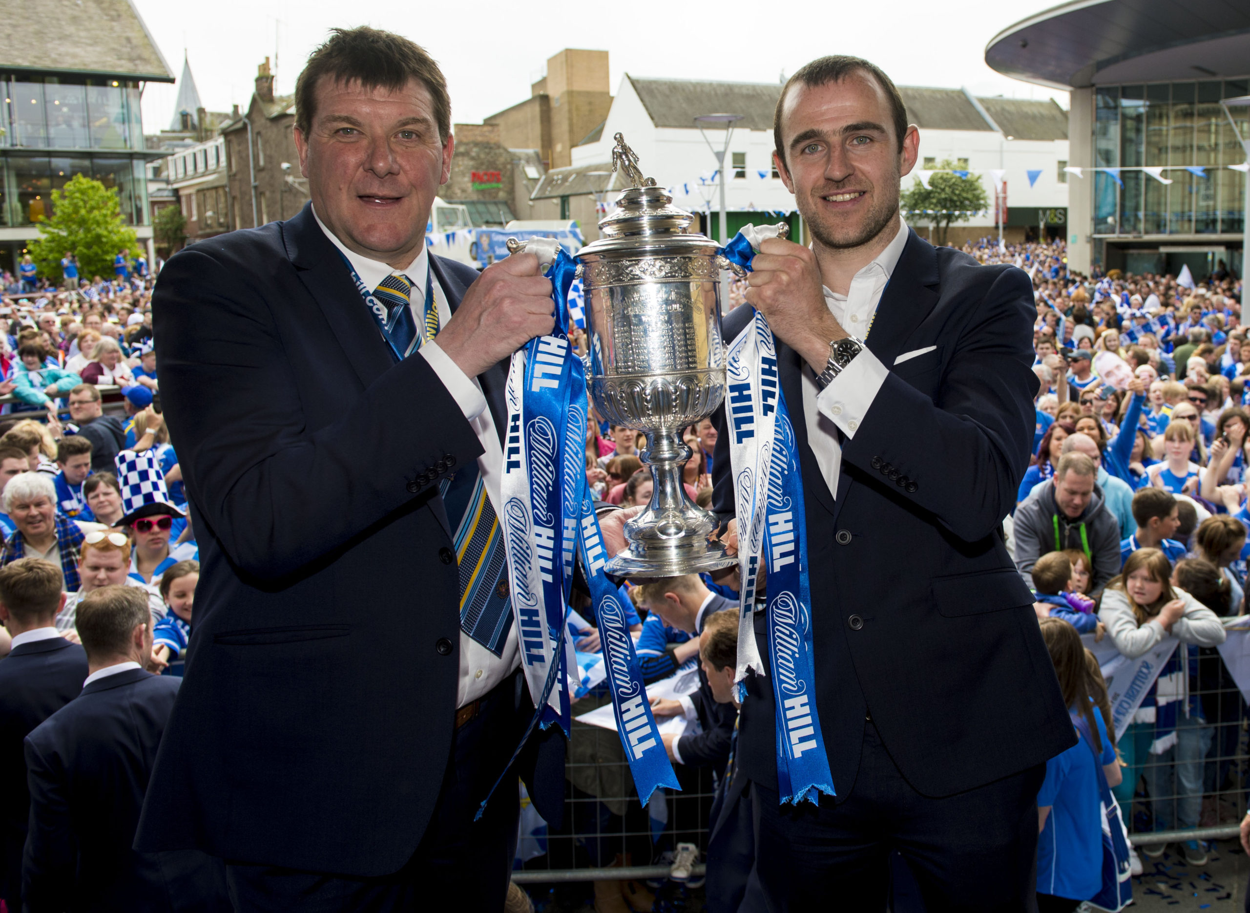 18/05/14 PERTH St Johnstone manager Tommy Wright (left) and captain Dave Mackay show off the Scottish Cup to the Perth public.