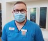 Therapeutic radiographer Greg Hampson wearing the smile behind the mask badge.
