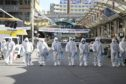 Workers wearing protective gear spray disinfectant as a precaution against the coronavirus at a market in Daegu, South Korea, which has been widely praised for its response to the coronavirus outbreak.