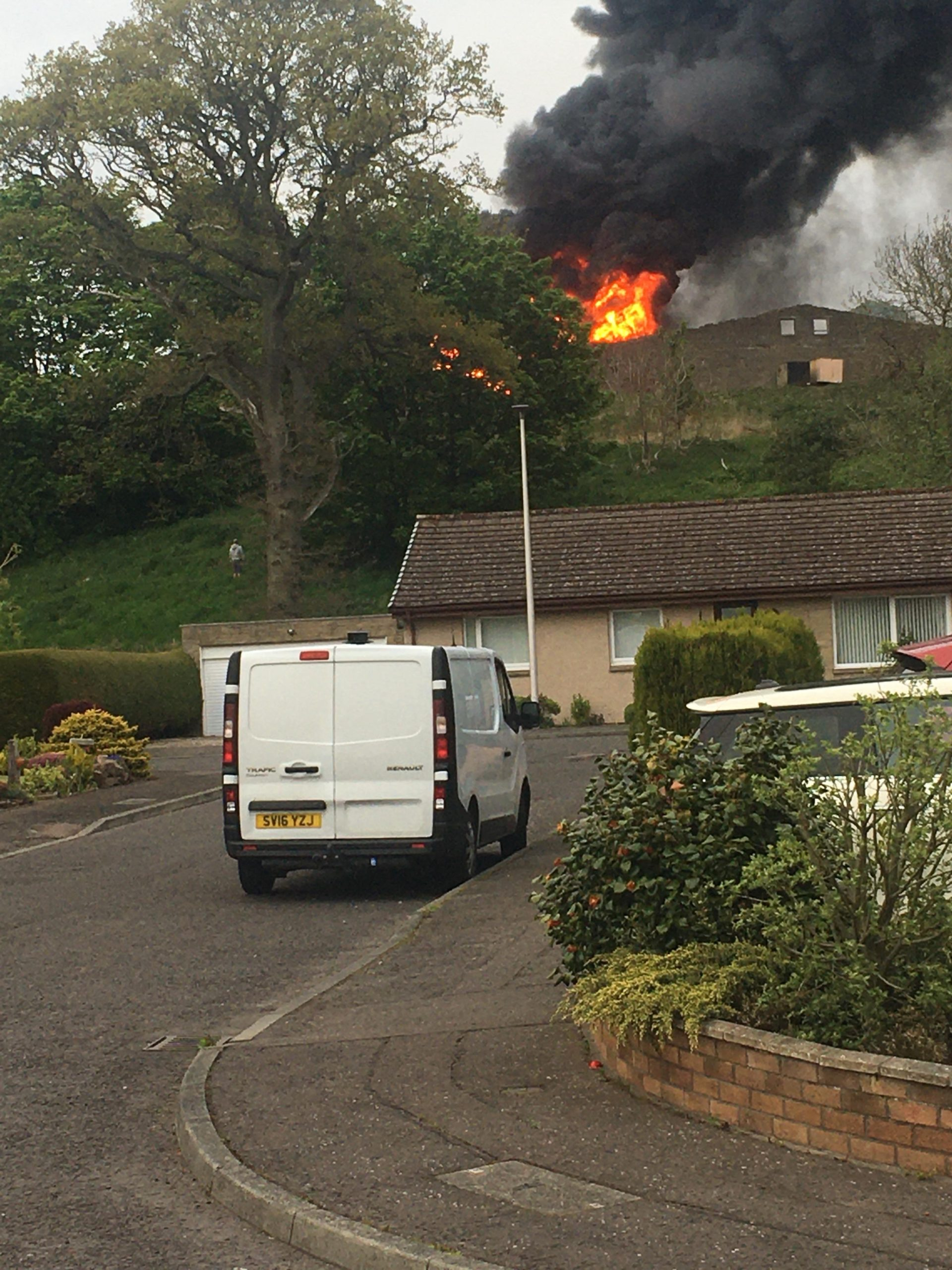 Fifefighters are dampening flames at the derelict shed in Barry, Carnoustie.