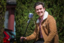 Singer and musician Finlay McKillop, 21, entertained residents with a garden gig.