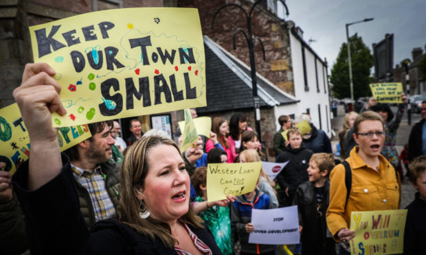 Residents took to the streets in protest of the plans for Pitdownies Farm.