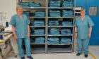 Tracey Caldwell (left) and Thelma Baxter from Tayside Linen Services with some of the Tayside Teal scrubs