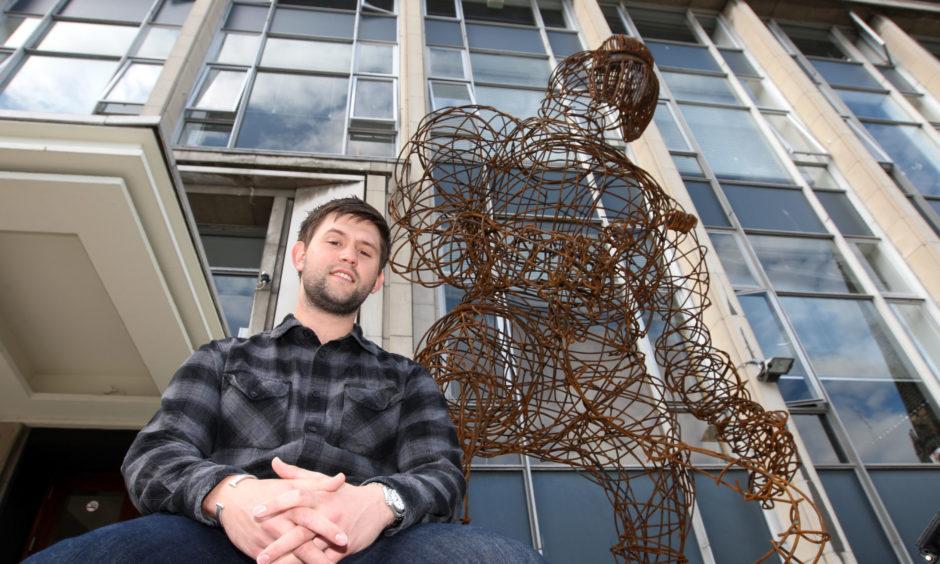 Duncan of Jordanstone, Dundee.  Student Stuart Turnbull with his sculpture 'The Welder'.