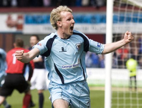 Gary Irvine celebrates a St Johnstone goal at Dens Park.