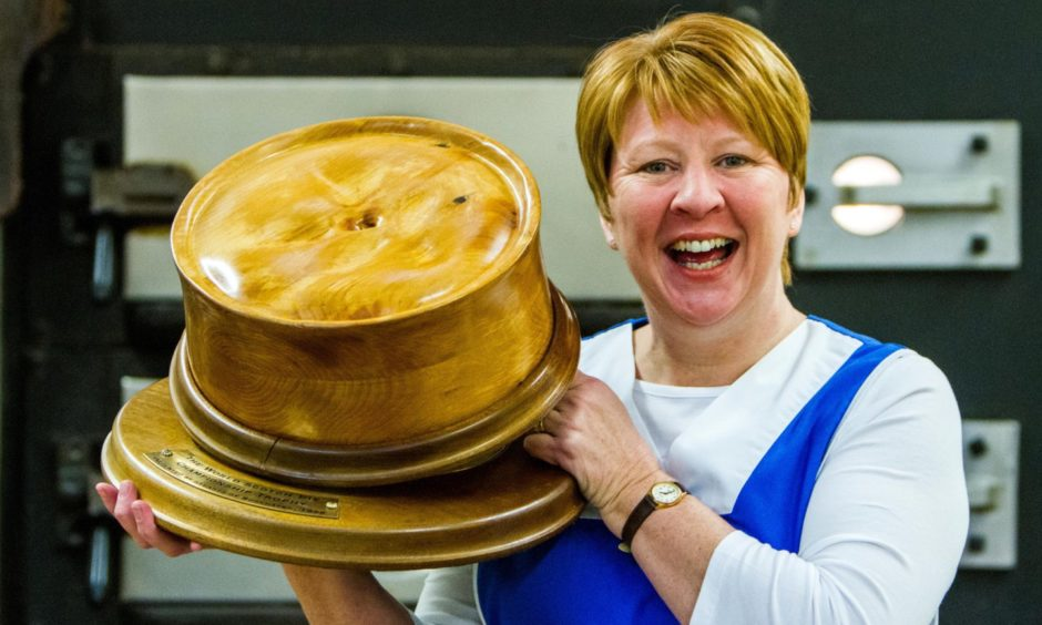 Linda Hill, of Murrays, with the trophy for winning the World Scotch Pie Championships.