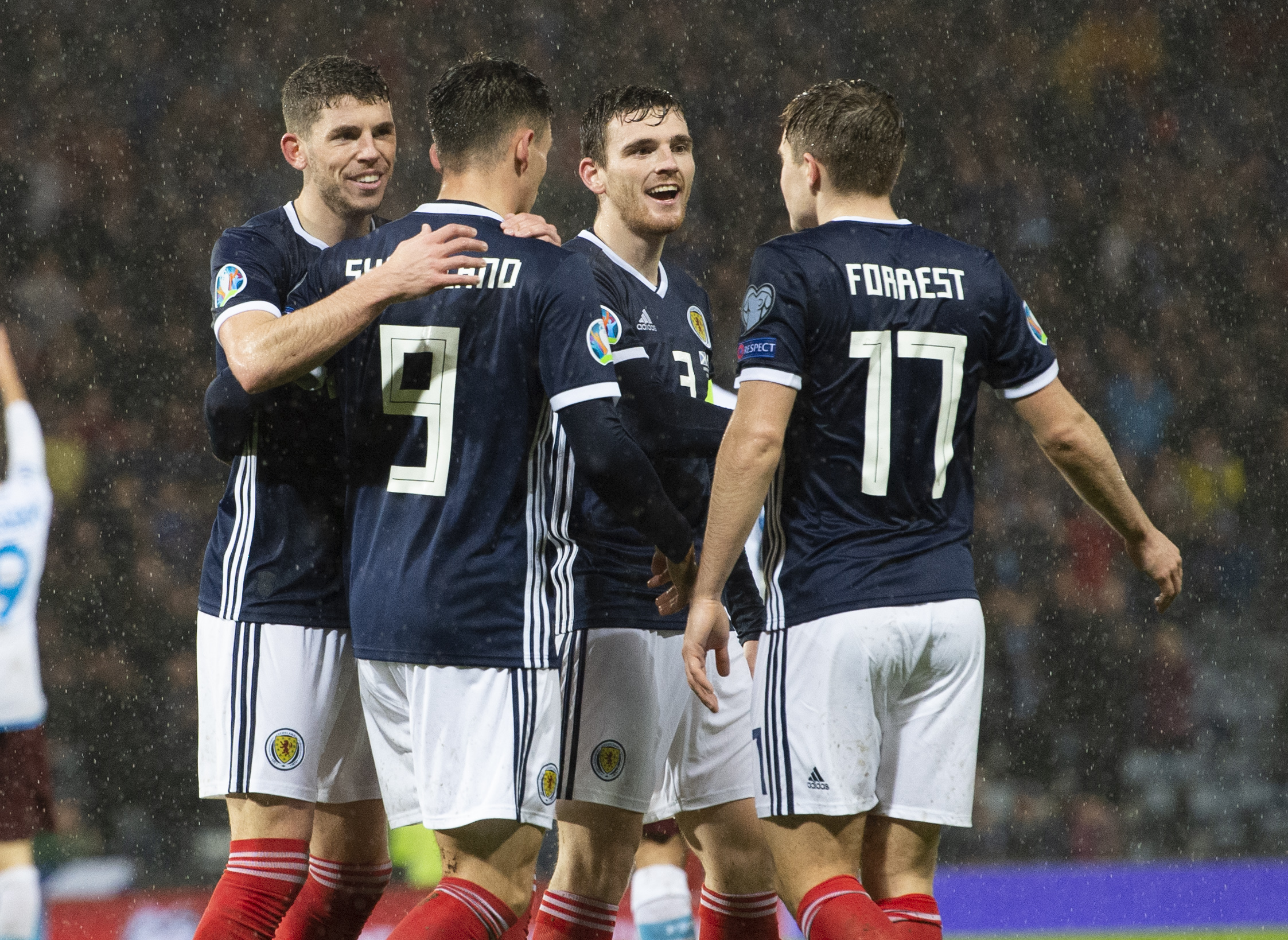 Dundee United's Lawrence Shankland celebrates his goal against San Marino with Scotland teammates Ryan Christie (left), Andy Robertson and James Forrest (right).