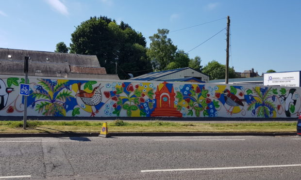 The wall mural on Queenswell Road.