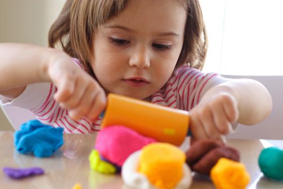 A toddler playing.