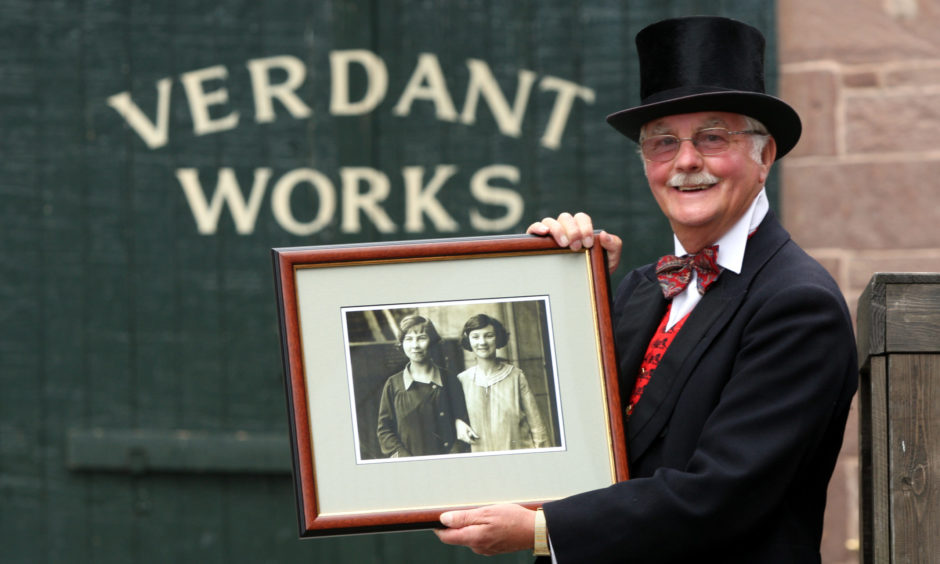 Verdant Works, Dundee.   Earl Scott picked up family resource leaflet and was amazed to see his mother on front. Pictured, Earl Scott with the enlarged original picture. His mother is the woman on the right.