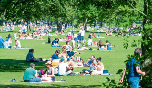 Members of the public enjoy the sun in Edinburgh after the easing of lockdown restrictions during the ongoing coronavirus pandemic, on May 30.