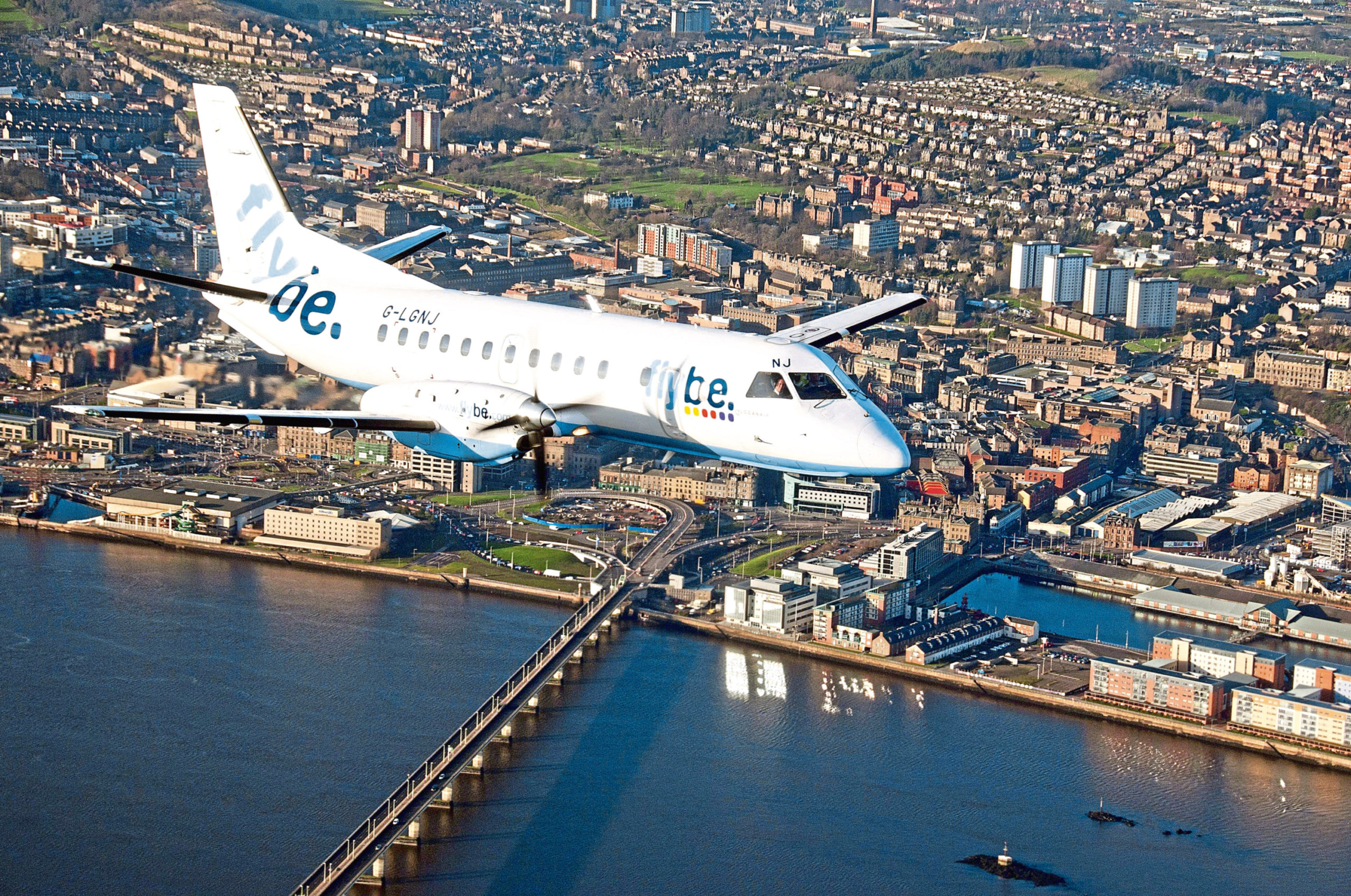 Loganair Flybe aircraft over Dundee A Loganair Flybe aircraft over Dundee.
