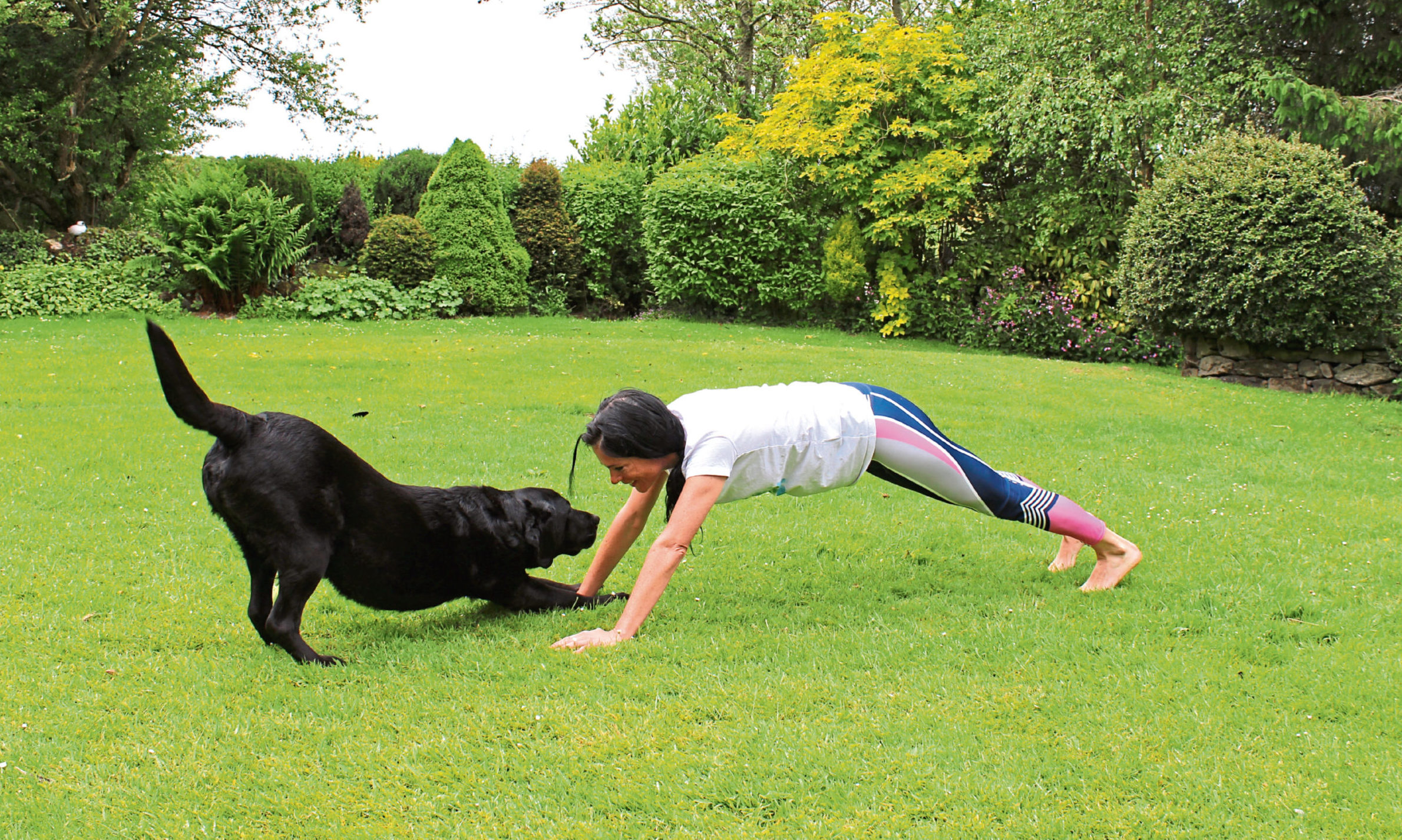 """Gayle tries """"doga"""" with her labrador, Toby!"""