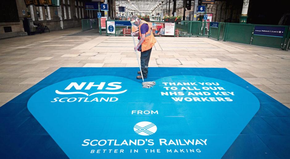 Members of the cleaning team at work in Waverley Station, Edinburgh.