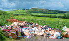 Fly tipping on the outskirts of Auchterhouse from what appear to be a store or local shop.