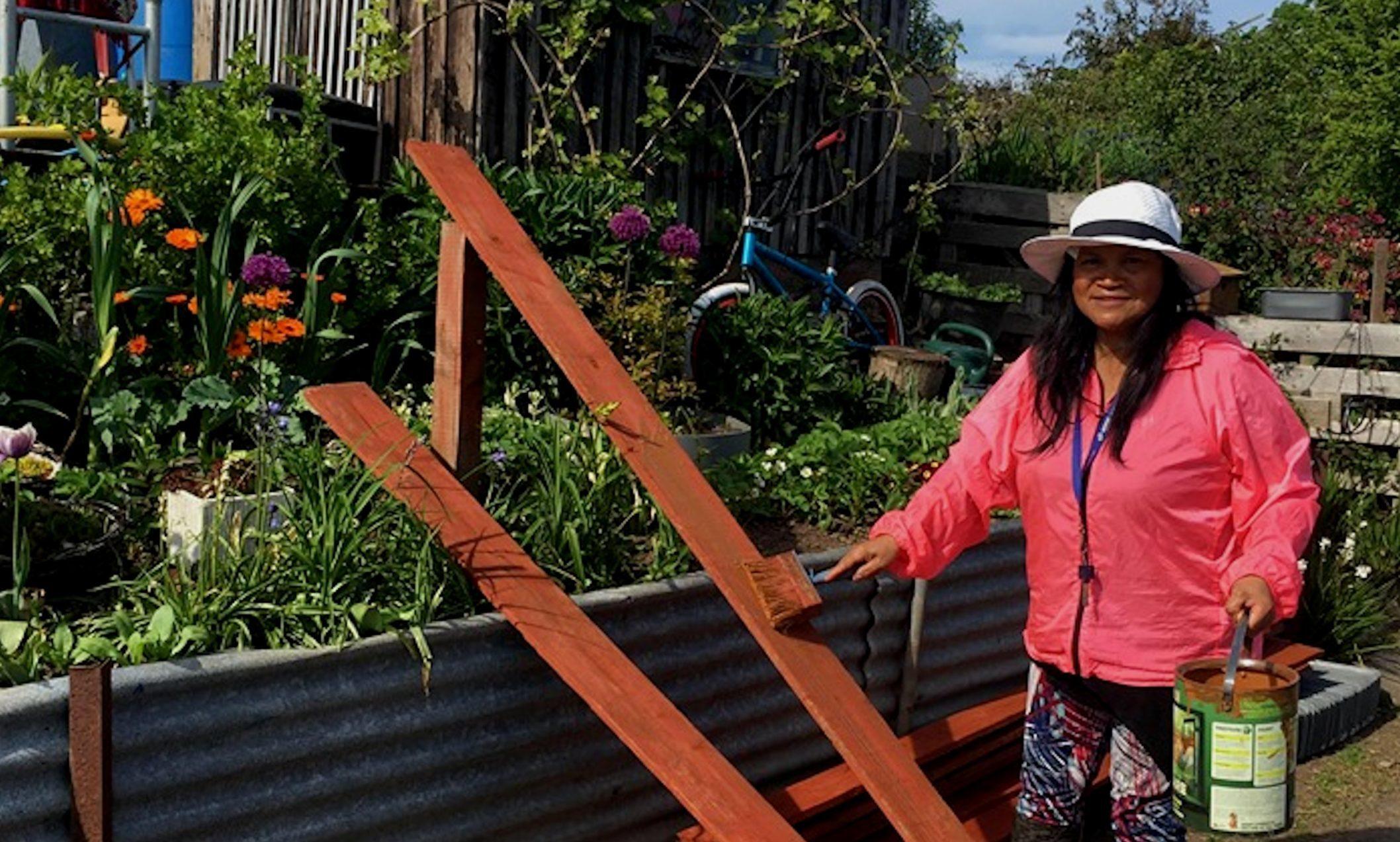 Auralia paints the new fence before erecting it