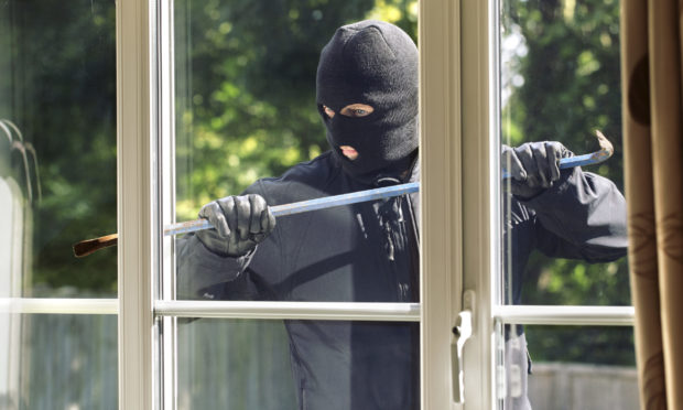 Men wearing balaclavas seen in care home grounds (image posed by model)