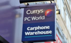 A Curry PC World sign