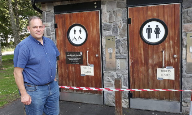 Councillor John Duff beside the closed public toilets at Aberfeldy