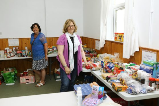 Benholm and Johnshaven community council chairwoman Mairi Eddie (right) and volunteer Kathryn Rojas, at the community larder.