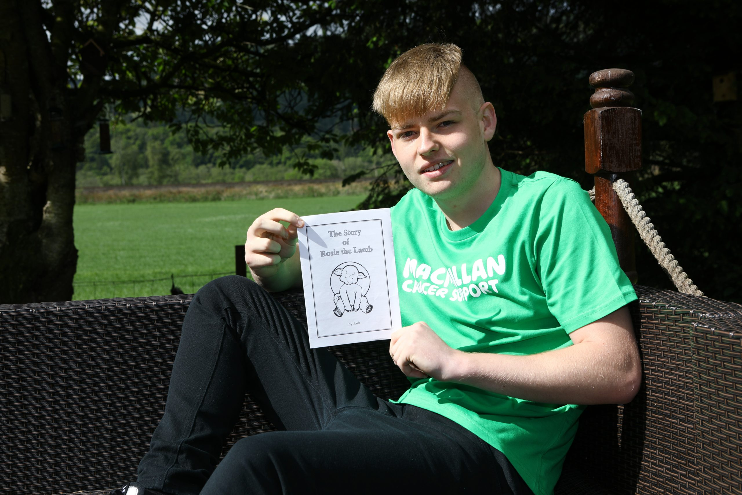 Josh Moran, 16, with his book published in aid of Macmillan. Picture: Dougie Nicolson.