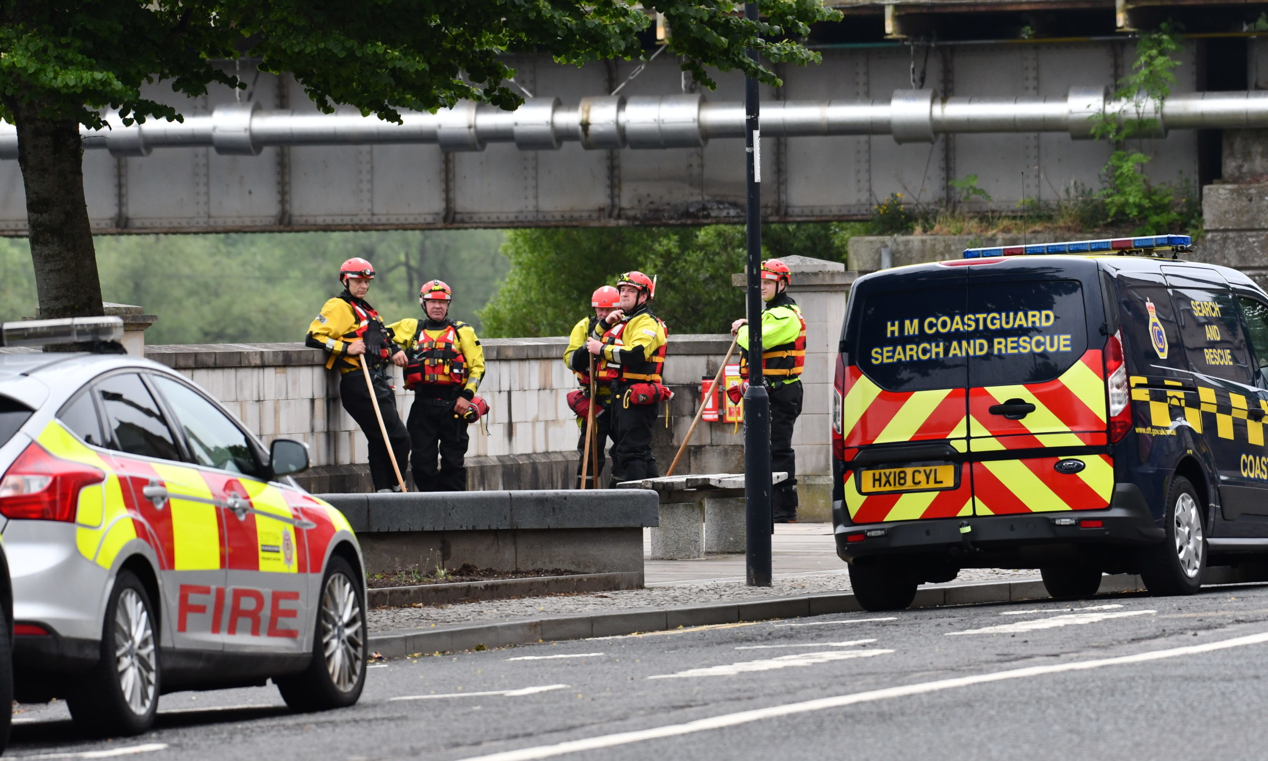 Rescuers flocked to Tay Street on Sunday morning.