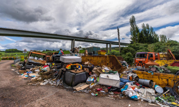 Fly-tipping under the Friarton Bridge in Perth